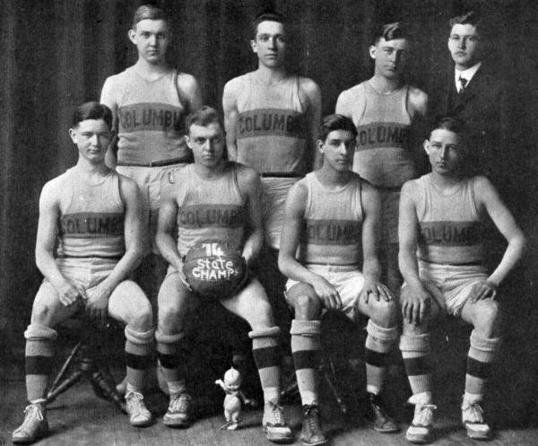 Members of the 1914 State Champion Basketball Team with the original Kewpie
